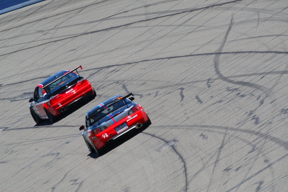 Ostby puts the Prima Racing Honda S2000 through Auto Club Speedway's high-speed banking