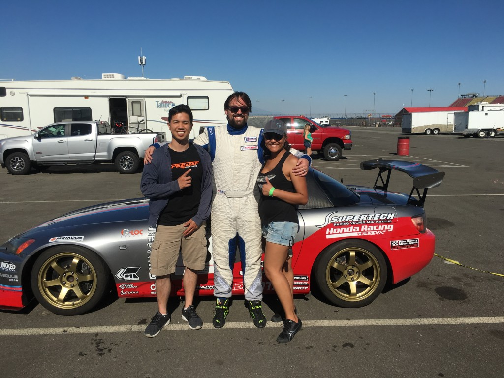 Driver Michael Ostby celebrates the successful completion of his very first race with team members James Tam and Lee-Anne Ostby