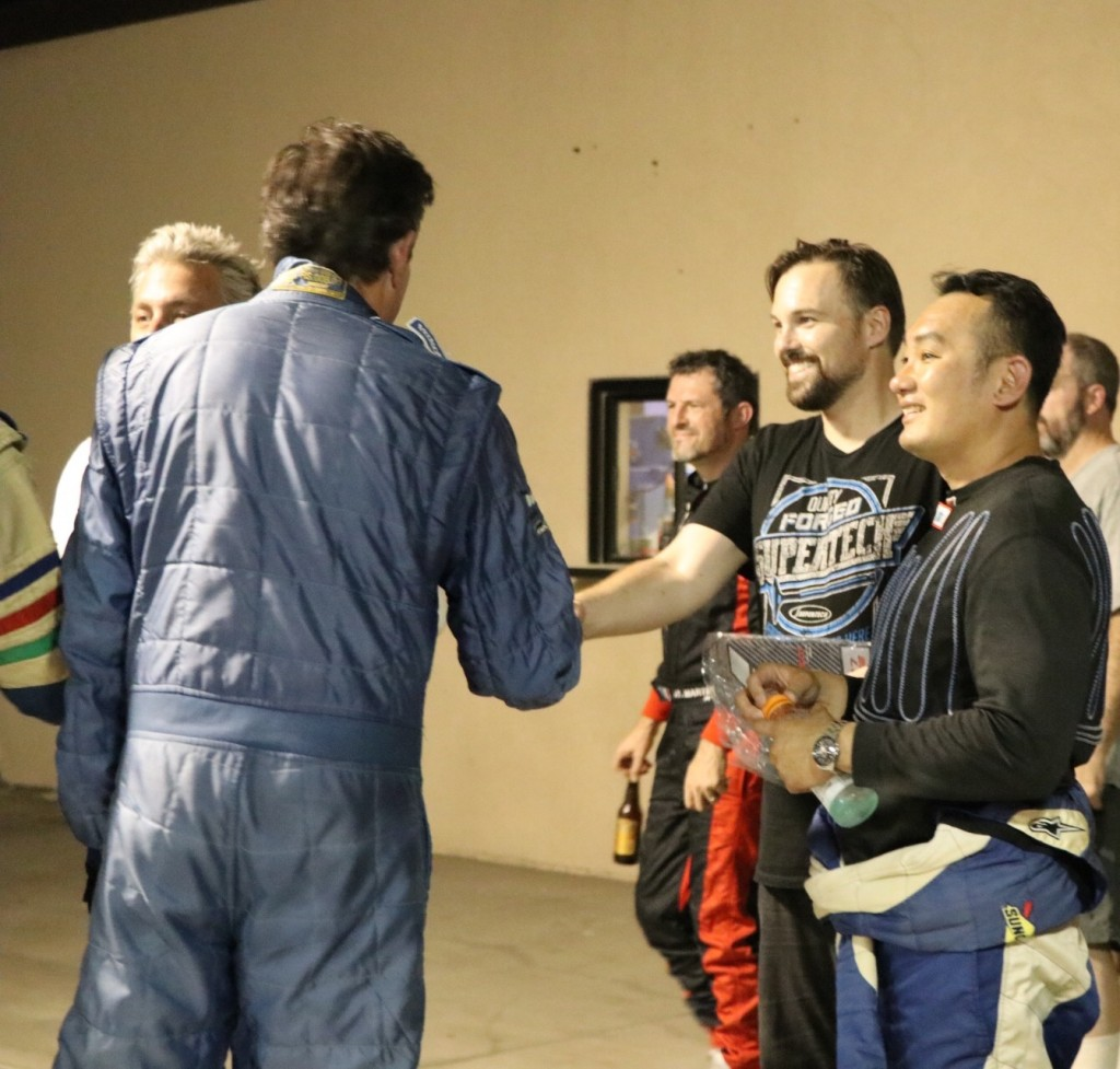Hartanto and Ostby congratulate their competitors in the E1 Class