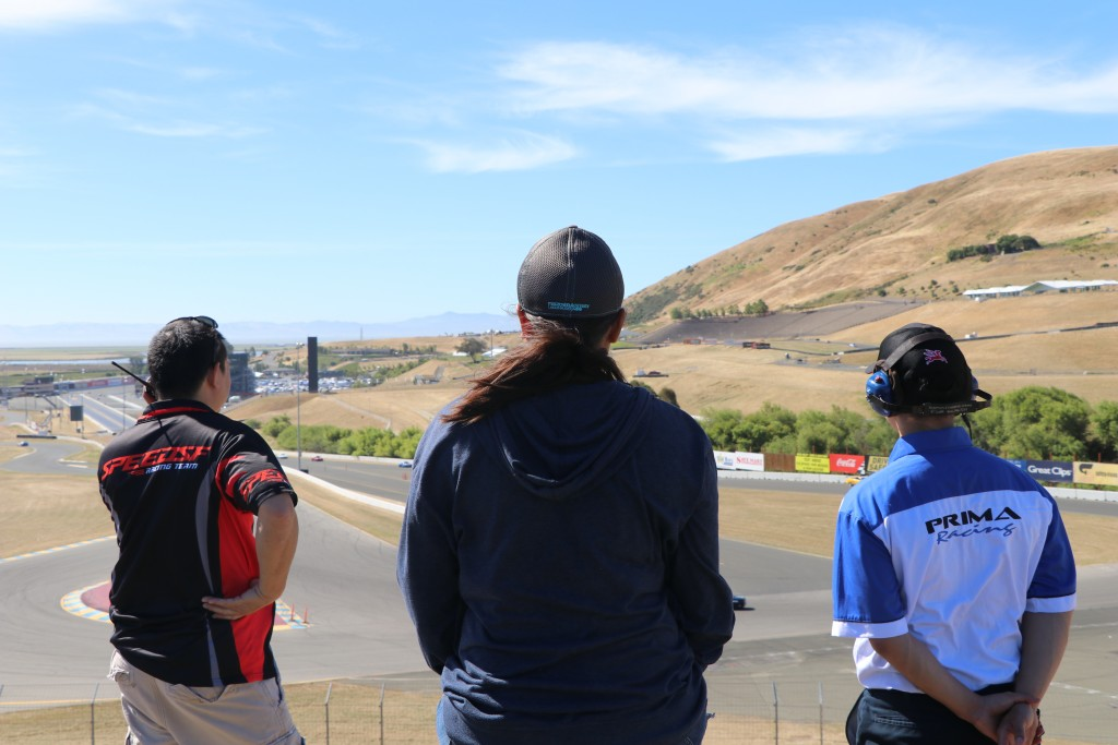 Left to Right - Speed SF Racing's Joe Chang and Prima Racing's Lee-Anne Ostby and James Tam watch on during Saturday's practice session