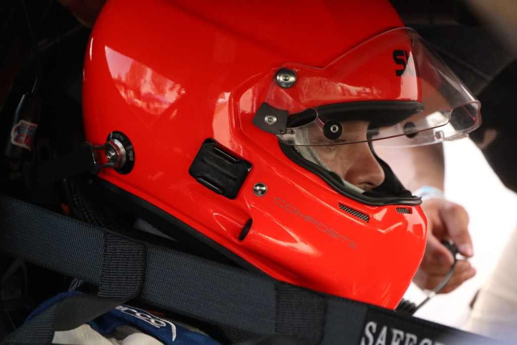 Michael Ostby tries to focus before taking to an unfamiliar track layout for qualifying. He would eventually go on to earn Pole Position in the E1 Class.
