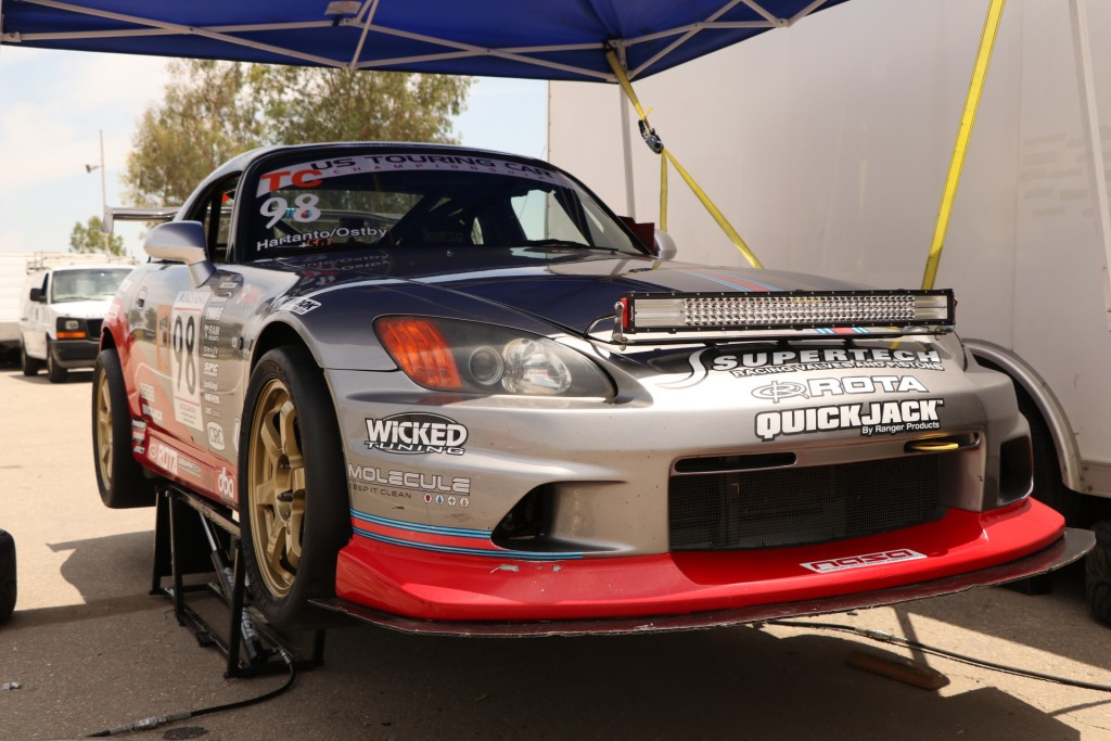 The Prima Racing Honda S2000 rests on the QuickJack, awaiting qualifying to begin