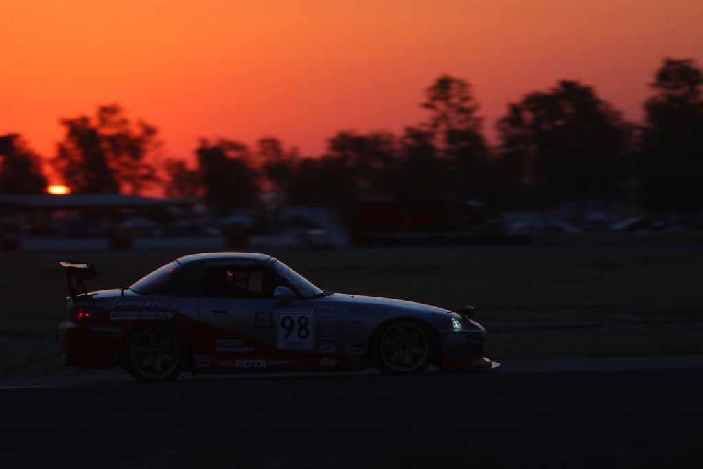 Driver and Team Prima Racing Captain, Andrie Hartanto, pushes the team's Honda S2000 into the night