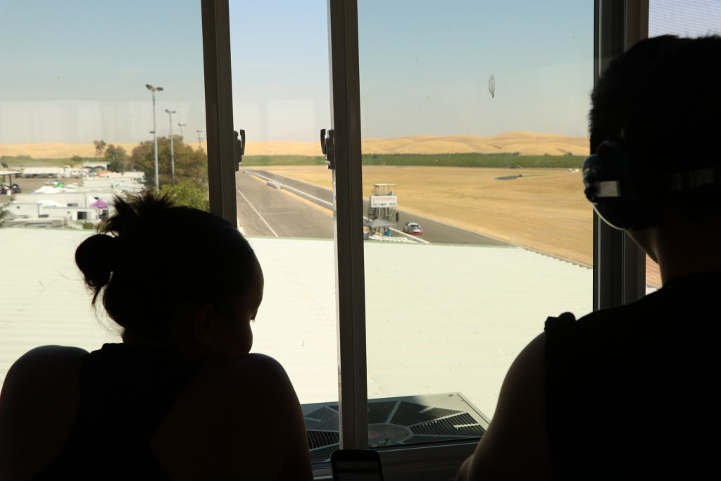 Team members Lee-Anne Ostby and James Tam observe qualifying from atop Thunderhill's tower
