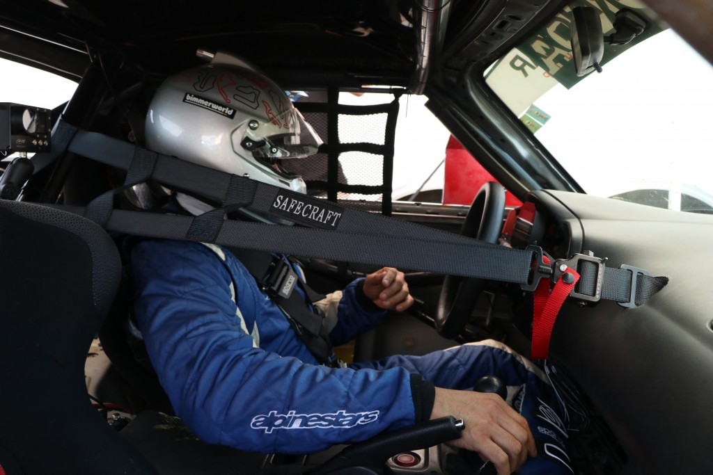 Hartanto is strapped in and prepared for the race. While he didn't log in the fastest qualifying time, he could confidently lean heavily on his experience and expert racecraft