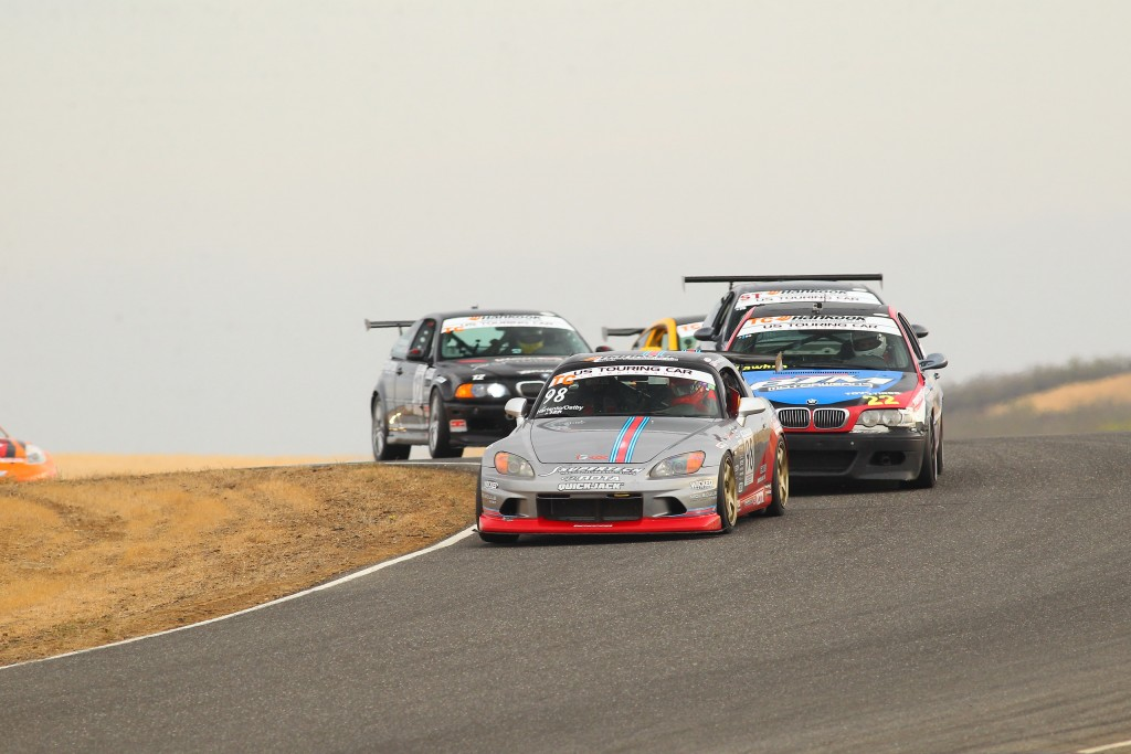 Following behind Gary Sheehan, Ostby leads the rest of the field during the opening lap