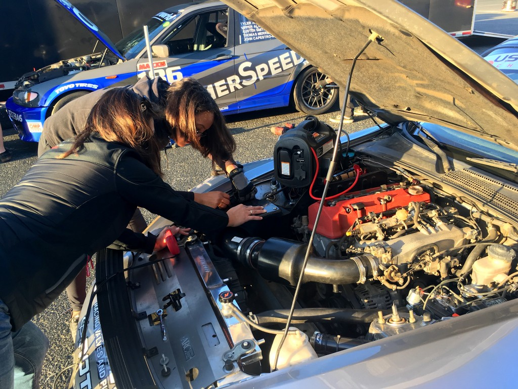Julie Hadi and Lee-Anne Ostby make a few adjustments to the S2000's new CT Engineering intake