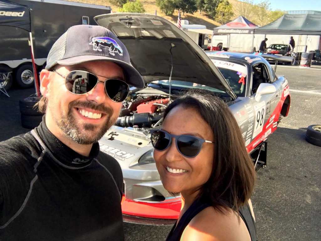 Michael and Lee-Anne Ostby are all smiles after earning the top qualifying spot on the E1 grid