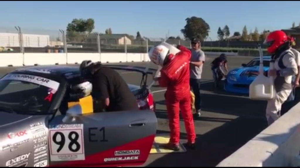 Lee-Anne Ostby facilitates the driver change while James Tam refuels the car